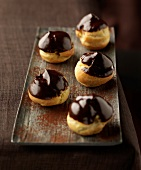 Choux buns coated in melted chocolate