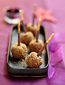 Chocolate and crushed hazelnut lollipops