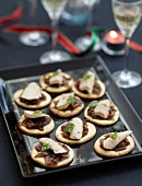 Foie gras and onion chutney tartlets