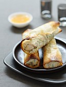 Nems (fried spring rolls, Vietnam) with chicken and herbs, sweet and sour