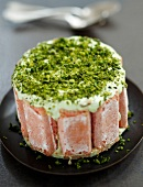 Pink Vacherin coated with crushed pistachios