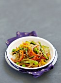 Vegetables cooked in a wok with soya sauce