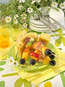 Fresh fruit brochettes and iced sponge cake