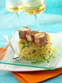 Swordfish and raw ham brochette, semolina with olives and sage