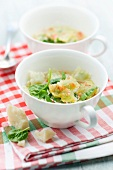 Small ravioli and spinach soup
