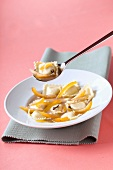Sweet raviolis with orange rinds and cloves