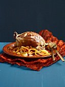 Stuffed pigeon with raisins and almonds