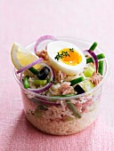Salade Niçoise in a plastic container