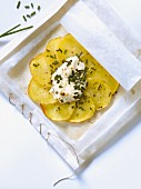 Potatoes with chives and cream cooked in wax paper