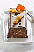 Chocolate,Calisson,dried fruit and candied fruit log cake