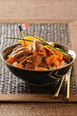 Pork with carrots,orange and rice