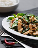 Thinly sliced chicken breasts with Thai basil