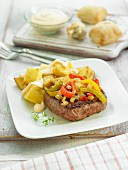 Grilled beef with bell peppers and potatoes