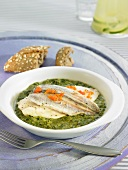 Blue whiting with creamy spinach and trout roe