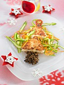 Christmas tree dish made with potato and monkfish omelette, mushrooms, carrots and zucchinis