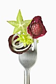 Fruit and vegetables on a fork