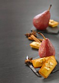 Pears poached in spicy wine, almond Financiers