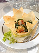Scallops and salmon cooked in a filo pastry casing