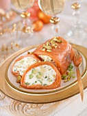 Seafood roll stuffed with goat's cheese, avocado and pistachios