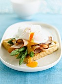 Poached egg, ham and asparagus on toast