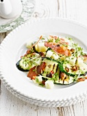 Warm zucchini and eggplant salad with almonds and chili peppers