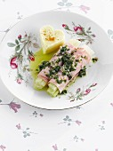 Celery stalk and boiled ham rolls with parsley dressing