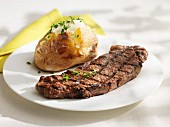 Grilled steak with baked potato