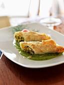 Ricotta and zucchini flower filo pastry rolls
