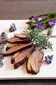 Grilled duck breast with rosemary