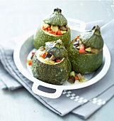 Round zucchinis stuffed with vegetables