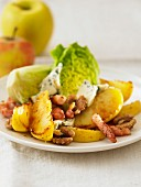 Lettuce with pan-fried apples and diced bacon