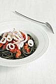 Squid ink pasta with squid and tomatoes