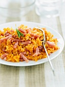 Rice with tomato sauce and diced bacon