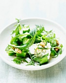 Cucumber cooked in a wok with goat's cheese and salad