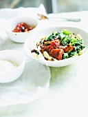 Pasta with spinach and stewed tomatoes