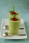 Cream of avocado and rocket lettuce, basil leaves and tomato-flavored ice cube