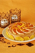 Sponge cake with butter cream and citrus fruit