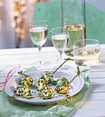 Goat cheese balls coated with pinenuts and parsley