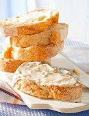 Cream cheese on sliced bread