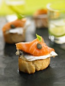 Anchovy, smoked salmon and caper crostini