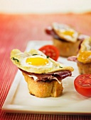 Spanish ham, fried quail's egg and tomato crostini