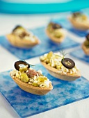 Anchocy, black pepper, egg and gherkin canapés