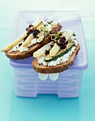 Cream cheese, zucchini, asparagus and tapenade open sandwich