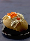 Baked potato with cream and salmon roe
