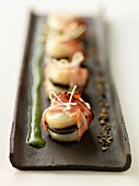 Scallop, truffle and streaky bacon appetizers with chervil sauce