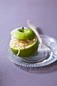 Grated celeriac and apple served in a Granny Smith apple