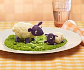 Cauliflower,purple potato and pureed pea dish representing sheep in a field