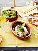 Roast cod with lemon and Provençal herbs, artichokes with coriander