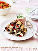 Grilled eggplant rolls stuffed with cheese,red peppers and rosemary