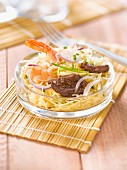 Thai-style sauteed shrimp and caramelized beef noodle salad